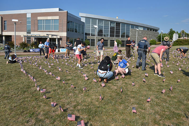 Planting American flags to remember those lost on 9/11