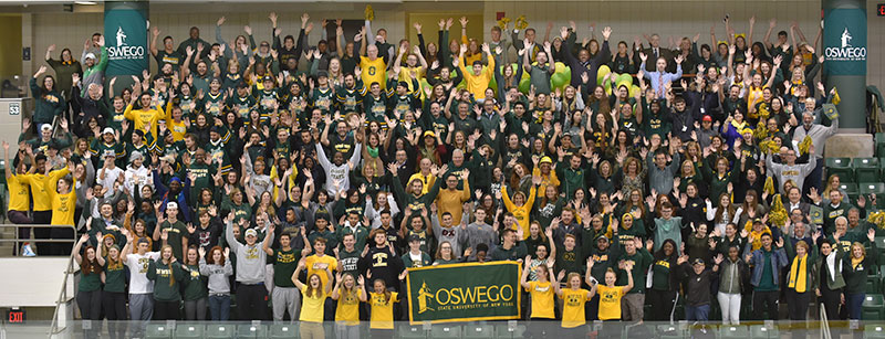 Gathering of the Oswego family in green and gold