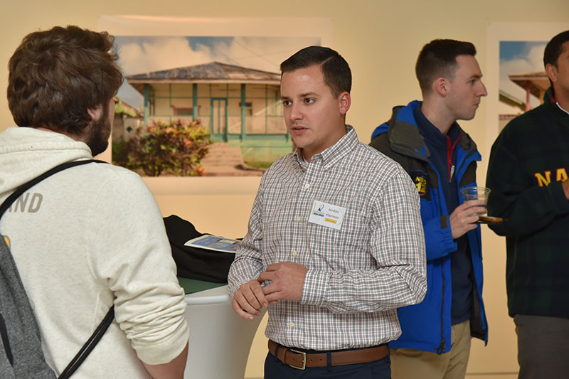 Jordan Harmon speaks to students at networking event