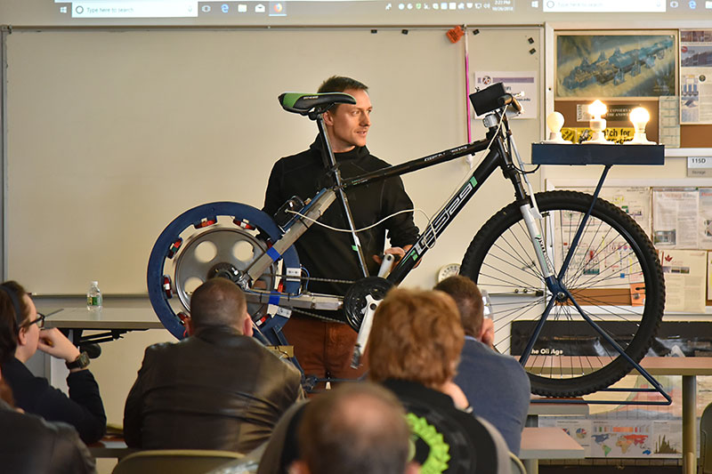 Presenter Michael Uchal shows his bicycle generator