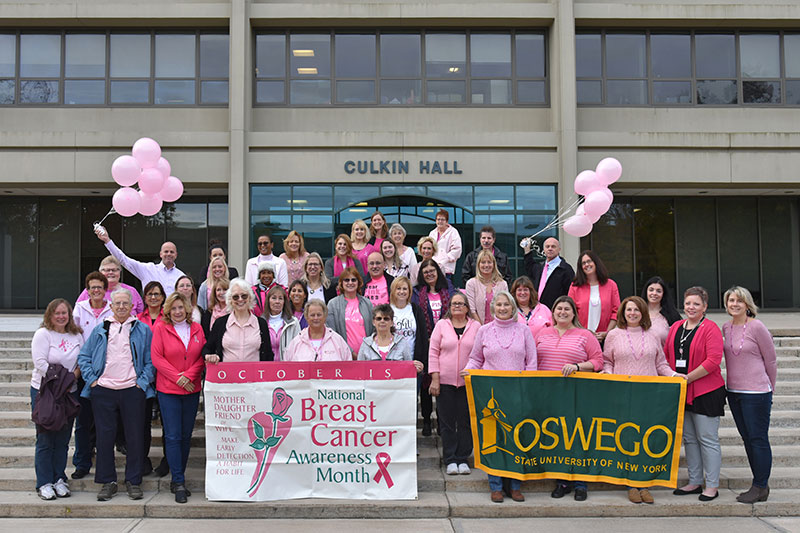 Employees dress in pink to raise awareness, funds to combat breast cancer