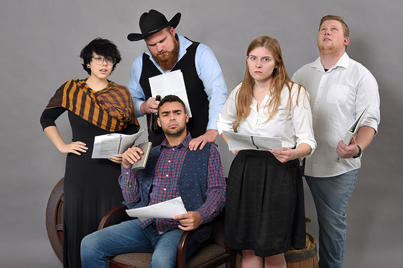 Cast members with scripts promote upcoming staged reading