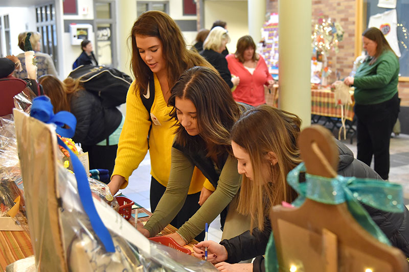 Students vote during Baskets of Caring fundraiser