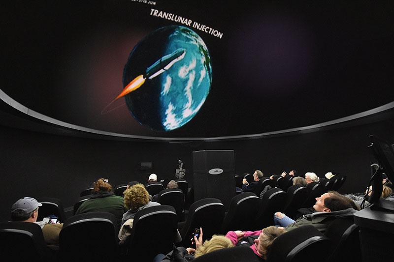Visitors enjoy planetarium show