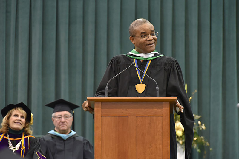 Community fixture Howard Gordon speaks to commencement crowd
