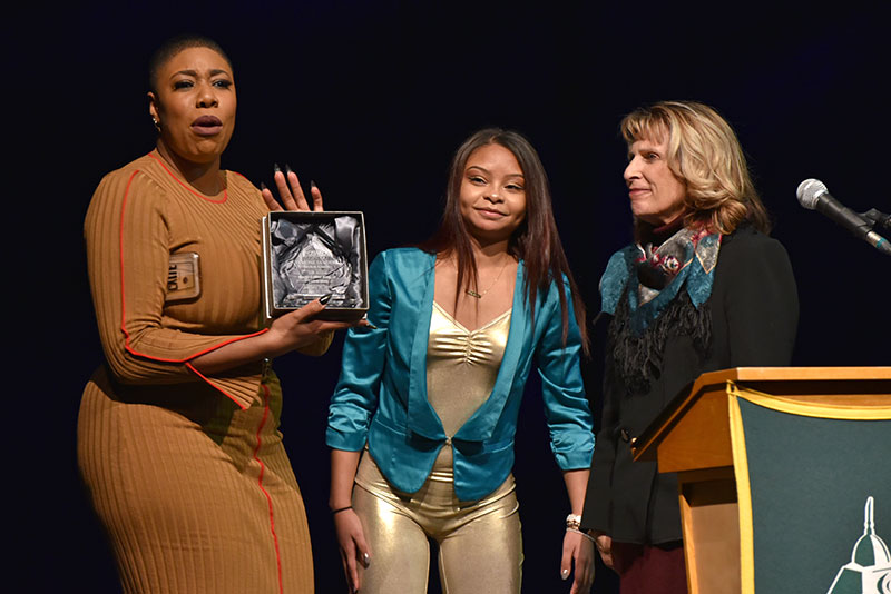 College presents Symone Sanders plaque of appreciation for MLK keynote