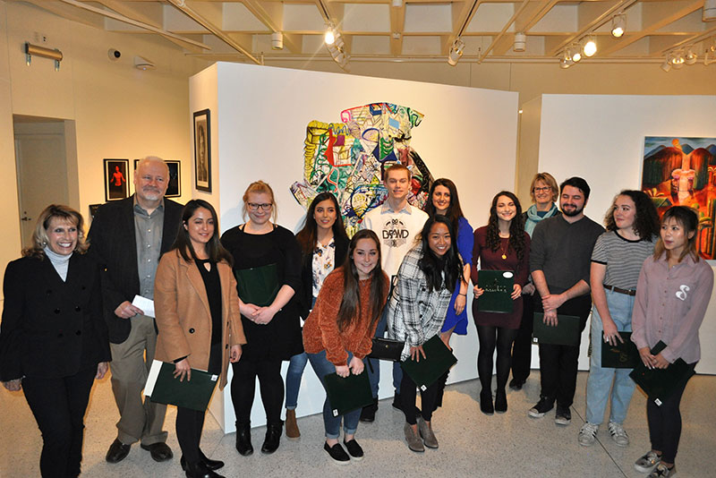 Students with work in juried art exhibition