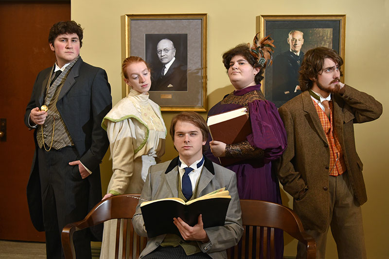Cast of The Good Doctor pose with books in period costumes