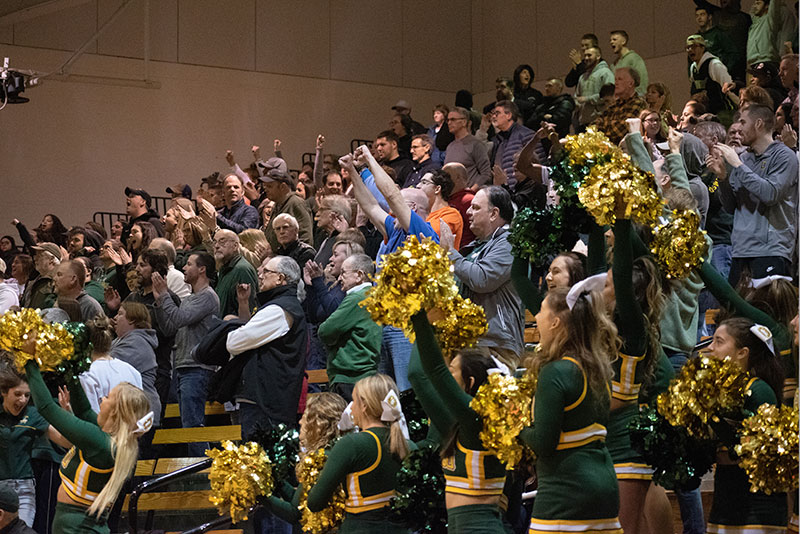 Fans and cheerleaders show their appreciation for the resilient Lakers men's basketball team during an NCAA win