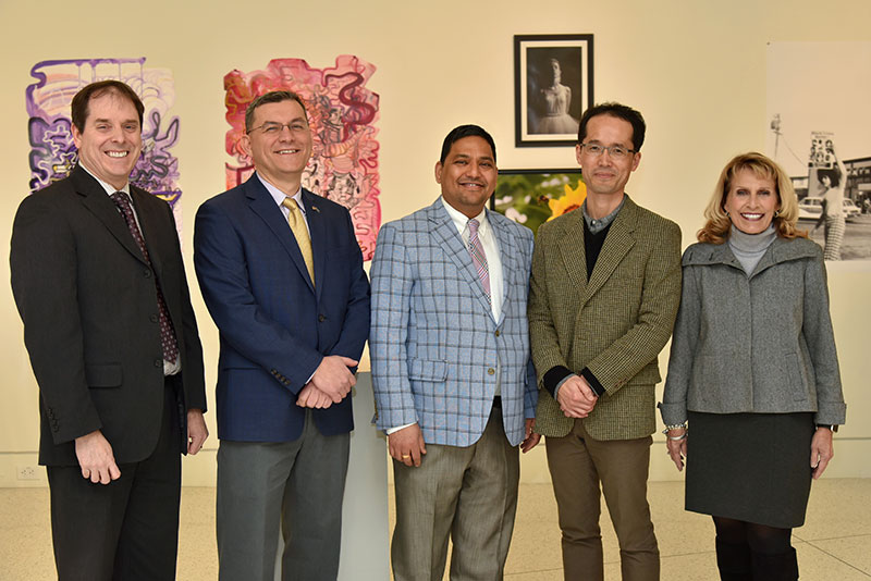 Provost Scott Furlong and college President Deborah F. Stanley flank new full professors Fehmi Damkaci, Arvind Diddi and Taejin Jung