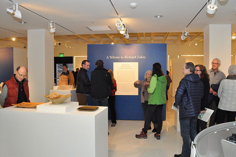 Visitors browse Faculty Art Exhibition