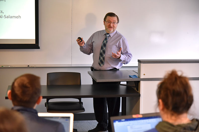 Edward Hale, an assistant administrative lab director at Oswego Health, makes a presentation