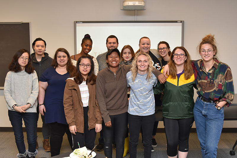 Alumna Jayme McCreary gathers with students active in Women in Computing and the Human-Computer Interaction Organization