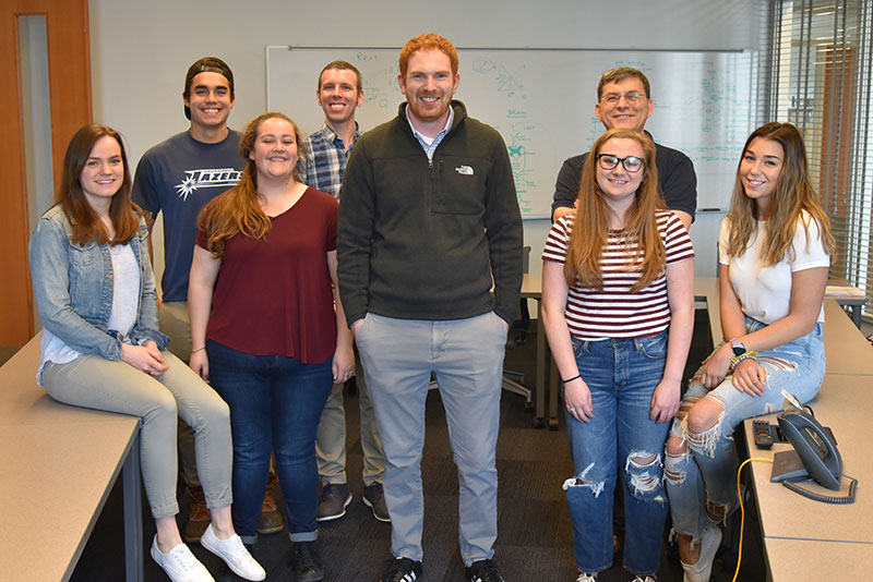 Dr. Brian Schultz meets with Chemistry Club students and faculty
