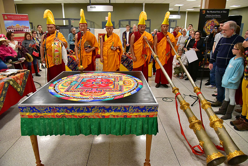 "Monks ready their 12-foot horns, a drum, cymbals and a bell as they chant during the closing ceremony of ""The Mystical Arts of Tibet"""