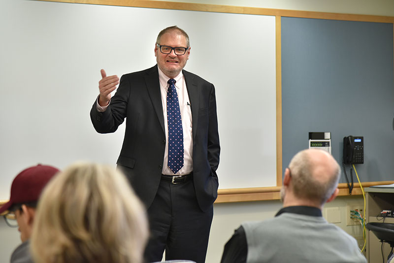 Thomas Mahl, an alumnus and chief of gastroenterology at the Veterans Administration in Buffalo, talks with students