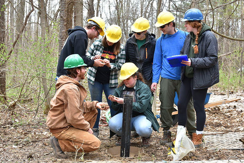 Justin Stroup's hydrogeology class inspects material from the drilling of new groundwater monitoring wells
