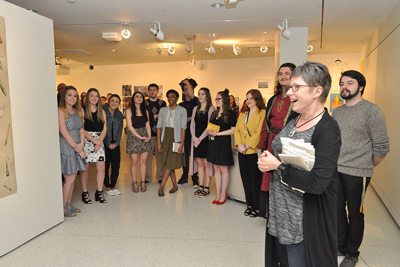 Student artists gather April 26 in Tyler Art Gallery at the opening reception for the BFA I, joining art faculty member Cara Thompson