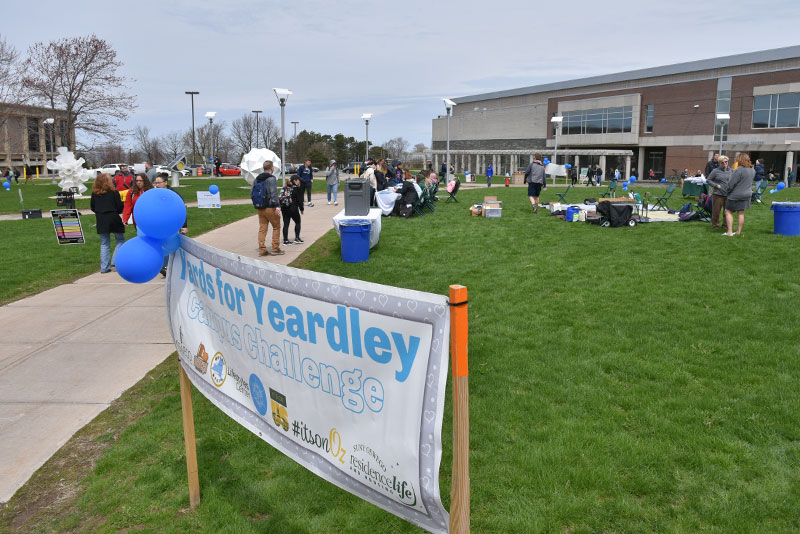 SUNY Oswego students, faculty and staff, as well as community members, walk to remember and to prevent domestic and dating violence during Yards for Yeardley