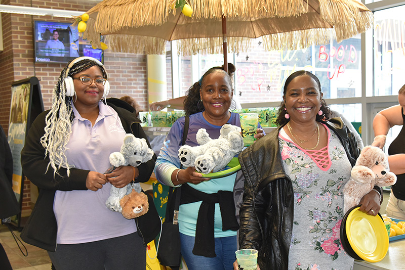 Yarbrielle Ingram (left), a May graduate with a master's degree in graphic design, enjoys OzFest on May 10 with her mother (center) and aunt (right)