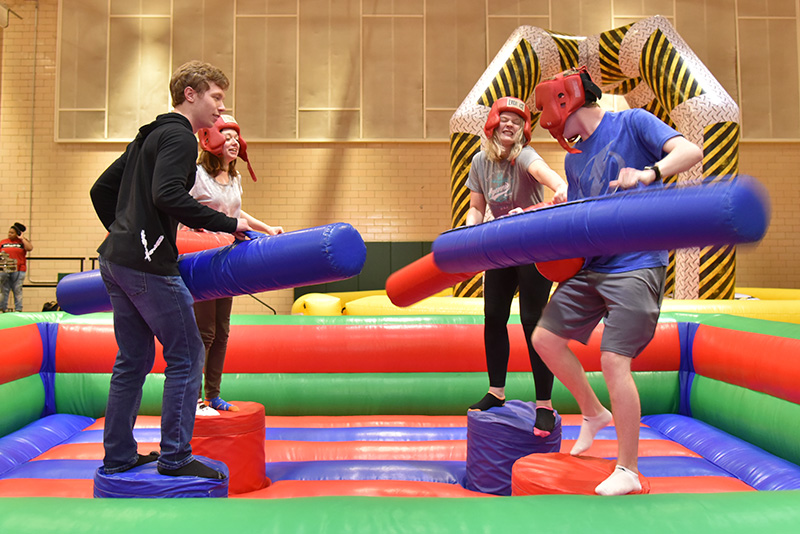 Student participate in an inflatable pugilistic game at OzFest