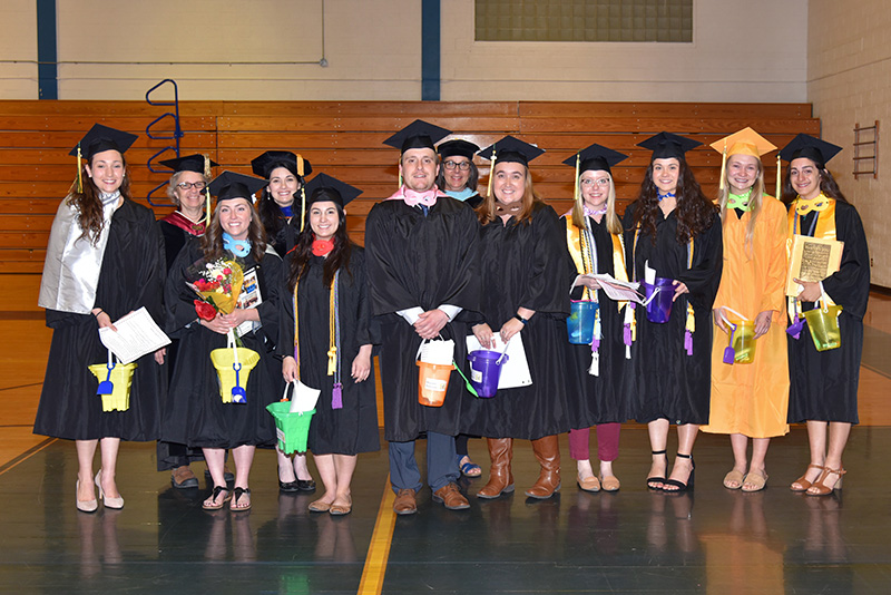Graduating student teachers and SUNY Oswego School of Education faculty members gather May 17 following a ceremony
