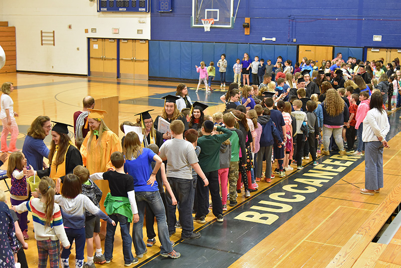 SUNY Oswego student teachers at Frederick Leighton Elementary School in Oswego enjoy a very special send-off with high-fives from children