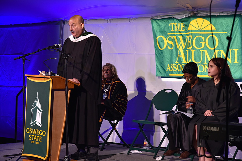 John McLoughlin addresses graduating seniors and a crowd of hundreds of others during the Torchlight Ceremony