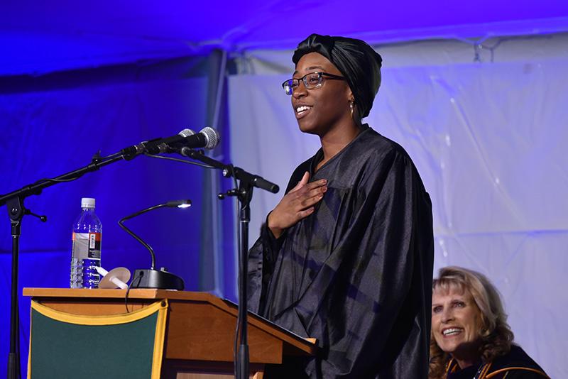 Tenaja Smith-Butler speaks during Torchlight Ceremony