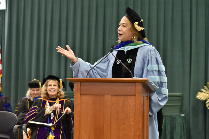 Dr. Mildred García, president of the American Association of State Colleges and Universities, addresses candidates for graduation