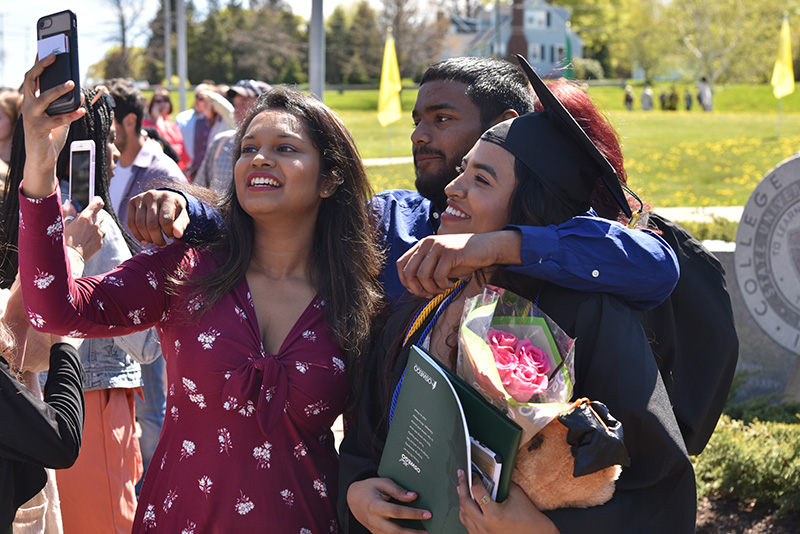 Many a joyous selfie with family and friends commemorated the sunny Commencement day