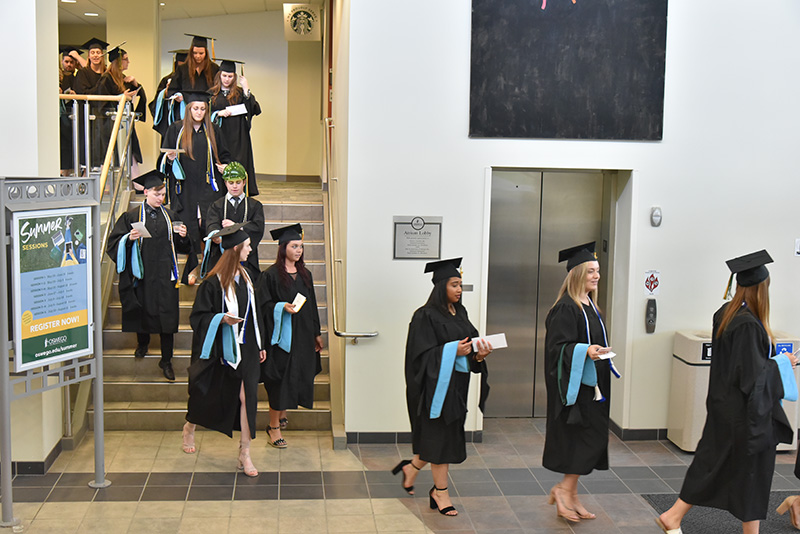 Candidates for graduate degrees and certificates leave the afternoon Division of Graduate Studies