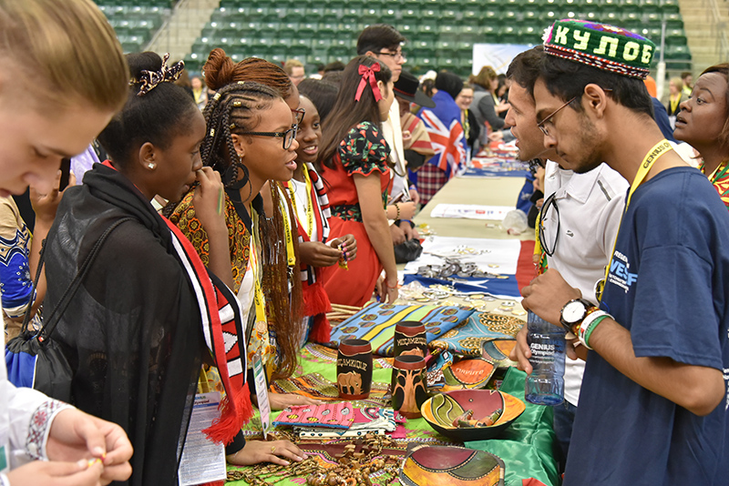 Students from Mozambique host a table at the GENIUS Olympiad International Fair
