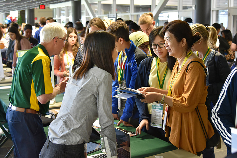 Students learn more about SUNY Oswego during the GENIUS Olympiad College Fair