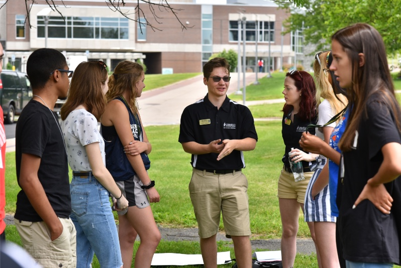 Laker Leaders lead a small Orientation group in the quad in front of Penfield Library