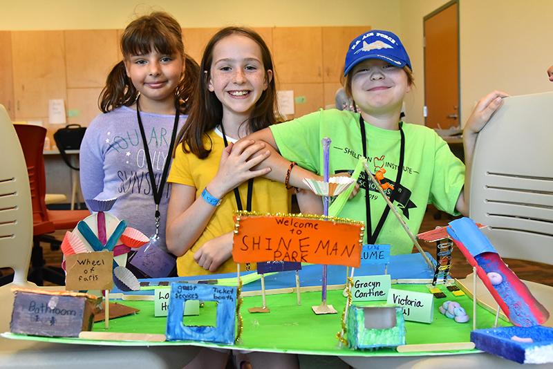 Students show off Shineman Park amusement park model