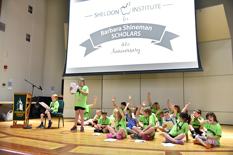 Youngest students at Sheldon Institute put on a skit about learning about community