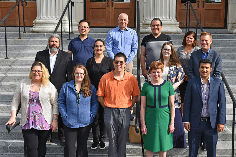 New faculty pose on the steps of Sheldon Hall