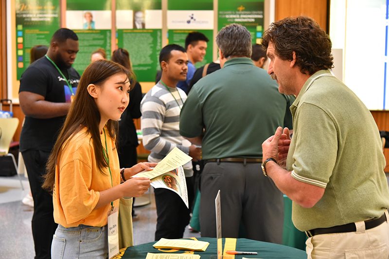 Steve Smith from the Writing Center talks with student Yoo Rim Kim from South Korea during International Student Orientation