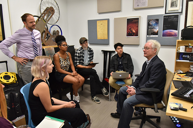 1973 graduate Tim Cooper (seated right), an acclaimed composer and music producer, visited campus to meet with students