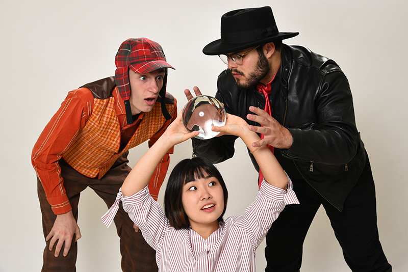 Rehearsal image from The Fantasticks as performers try to gaze into the future