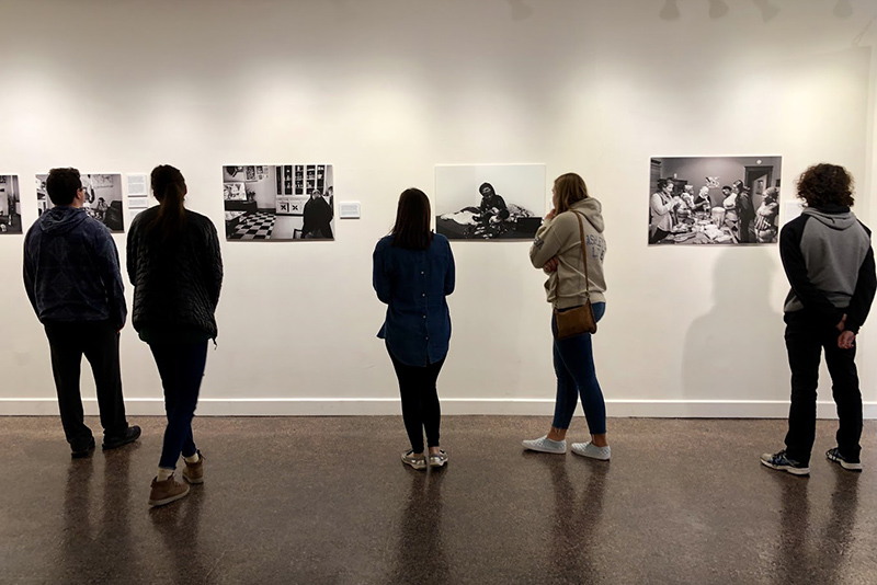 Students look at Recreating Home: Photography of the Refugee Experience exhibition