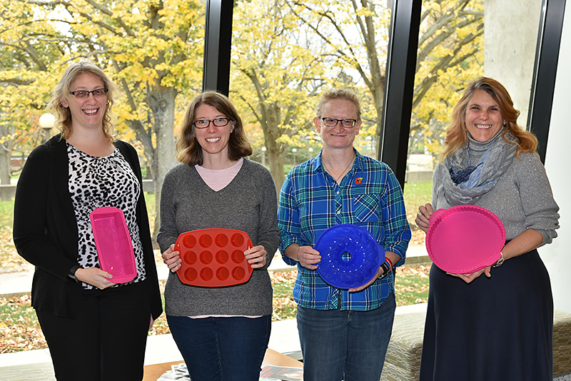 Holding some of the new silicone bakeware as winners from the three State Employees Federated Appeal Bake Offs are, from left, Jenny Grass, EXCEL office; political science faculty members Allison Rank and Helen Knowles; and Angela Galvin, Office of the Vice President for Administration and Financ