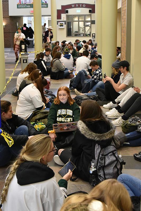 Students wait in line for Oswego-Plattsburgh men's hockey game