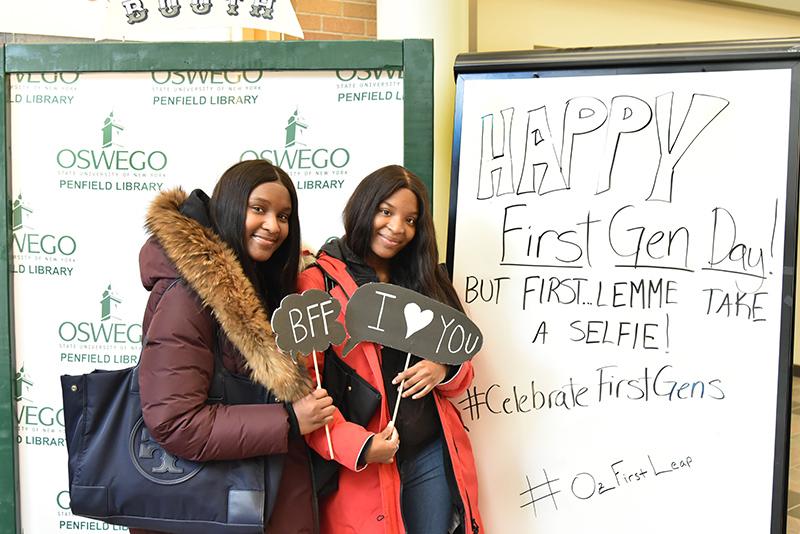 Denasia Wilson (left), a human development major, and Deneisha Wilson, a history major, celebrate First-Generation Students Day
