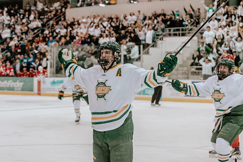 Junior defenseman Carter Allen of the Oswego men's hockey team celebrates his first-period goa