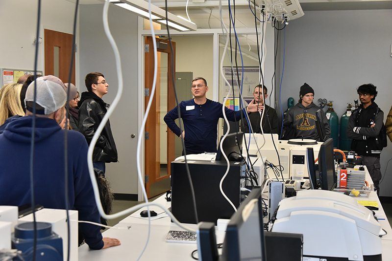 Chemistry department chair Fehmi Damkaci leads a tour group through the chemistry labs in the upper Innovations Wing of the Shineman Center during the Nov. 11 Admissions Open House.