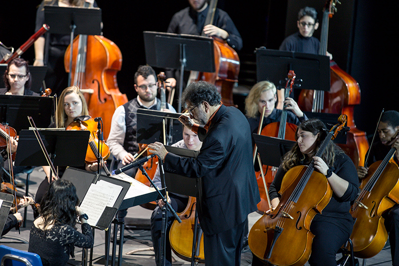 Music professor Juan LaManna directs the College-Community Orchestra