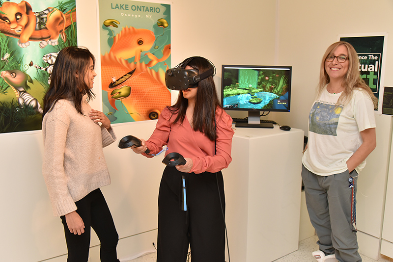 Pragya Pahari demonstrates her virtual reality project during the opening reception for the Bachelor of Fine Arts exhibition at Tyler Art Gallery