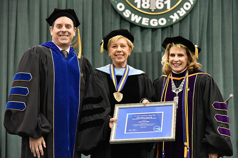 Dr. Irene Scruton (center), assistant dean and director of MBA programs in the School of Business, for receives a 2019 SUNY Chancellor's Award for Excellence in Professional Service.